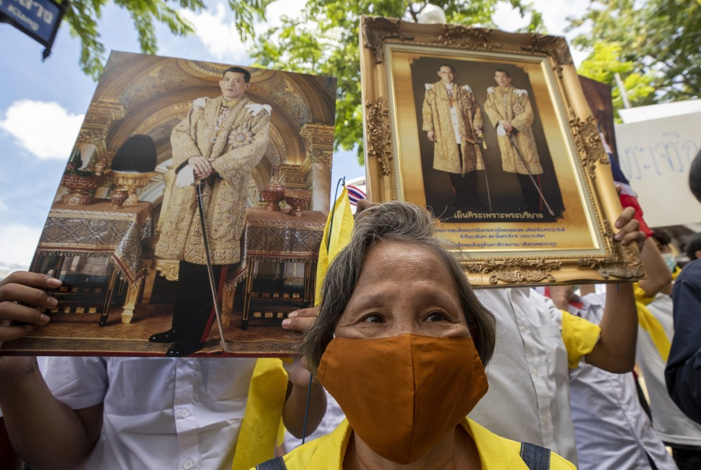 Supporters of Thailand's monarchy hold portraits of King Maha Vajiralongkorn and portraits of the late King Bhumibol Adulyadej as they gather to show ...