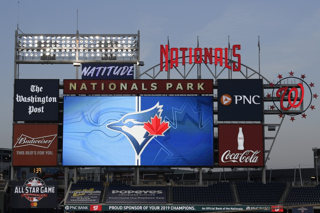 The Toronto Blue Jays' logo is displayed on the scoreboard during the middle of the eighth inning of the team's baseball game against the Washington N...