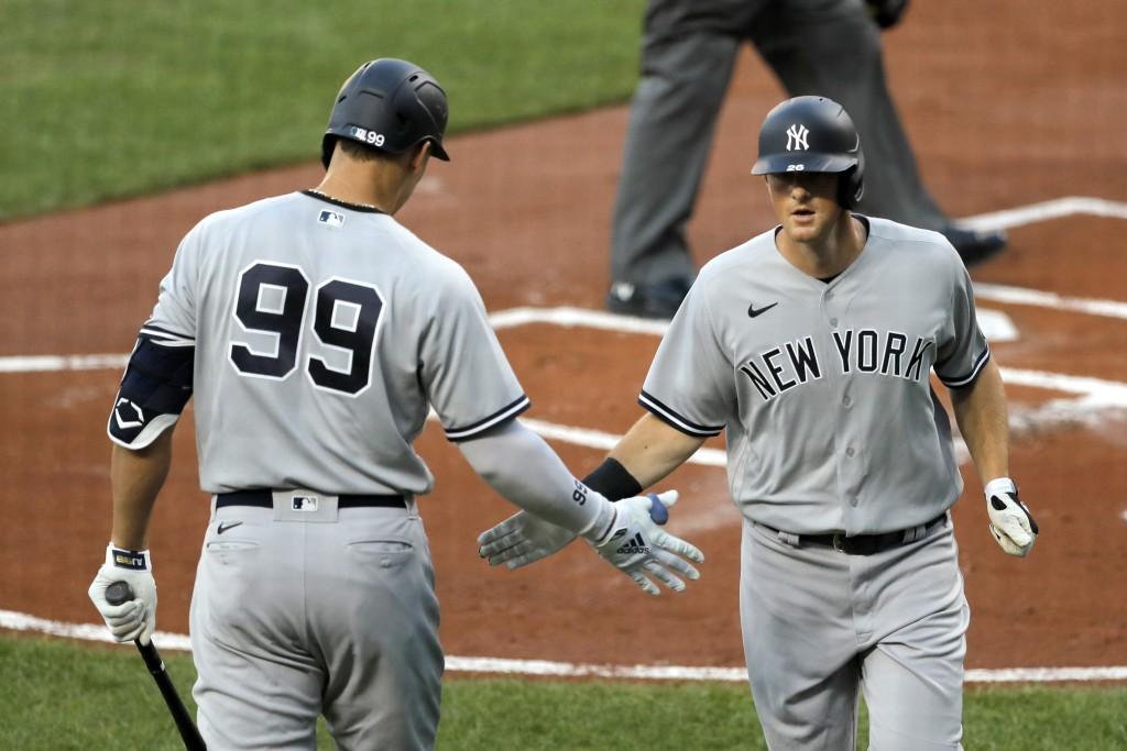 New York Yankees' Aaron Judge (99) greets DJ LeMahieu, right, after LaMahieu hit a solo home run off Baltimore Orioles starting pitcher Asher Wojciech...