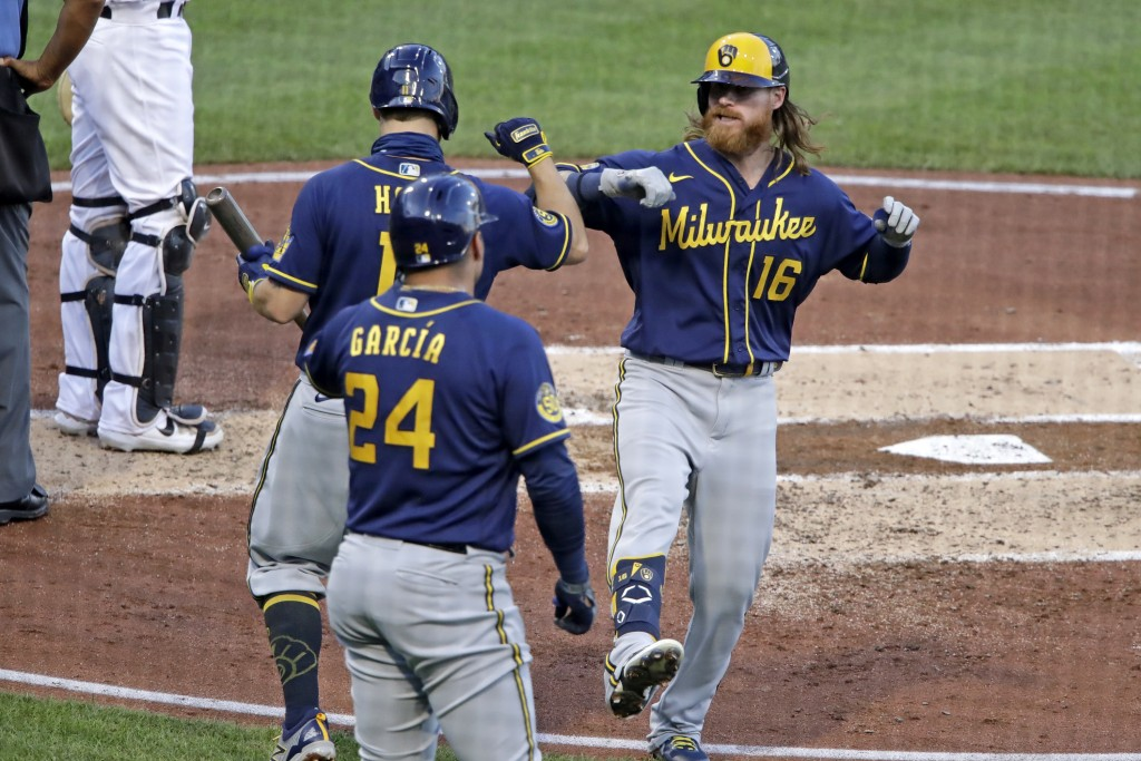Milwaukee Brewers' Ben Gamel (16) celebrates with Brock Holt (11) and Avisail Garcia (24) after hitting a two-run home run off Pittsburgh Pirates star...