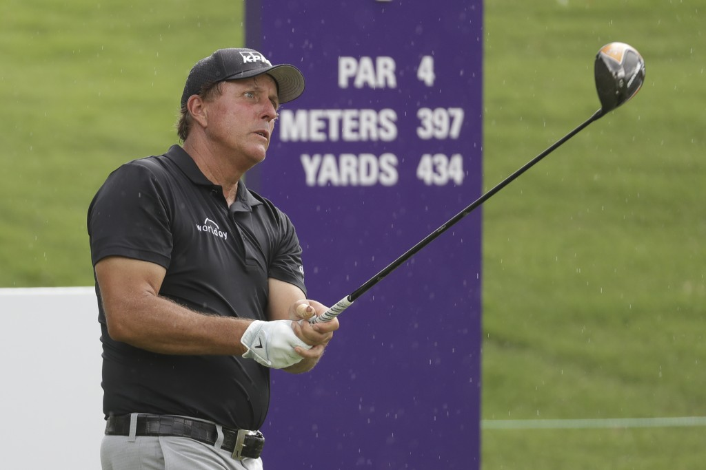 Phil Mickelson fits from the first tee during a practice round at the World Golf Championships-FedEx St. Jude Invitational Wednesday, July 29, 2020, i...