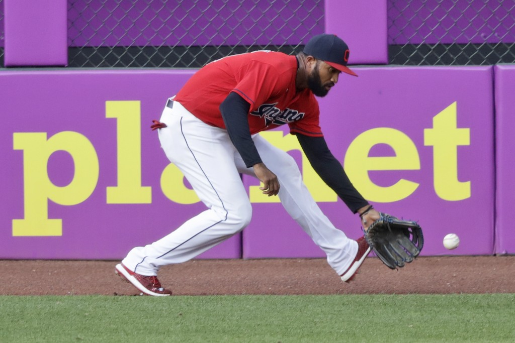 Cleveland Indians' Domingo Santana fields a ball hit by Chicago White Sox's Adam Engel in the sixth inning in a baseball game, Wednesday, July 29, 202...