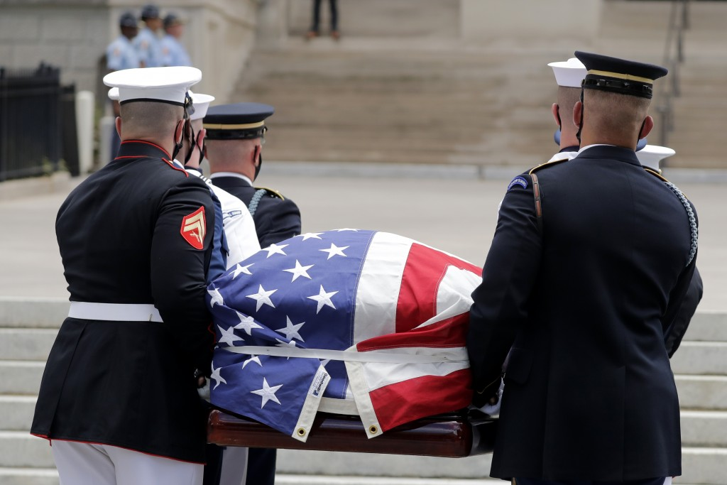 The casket of Rep. John Lewis is carried into the capital as Lewis will lie in repose, Wednesday, July 29, 2020, in Atlanta. Lewis, who carried the st...