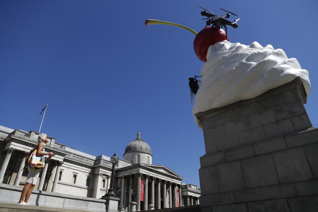 A new work of art entitled 'The End' by artist Heather Phillipson is seen after it was unveiled on the fourth plinth in Trafalgar Square in London, Th...