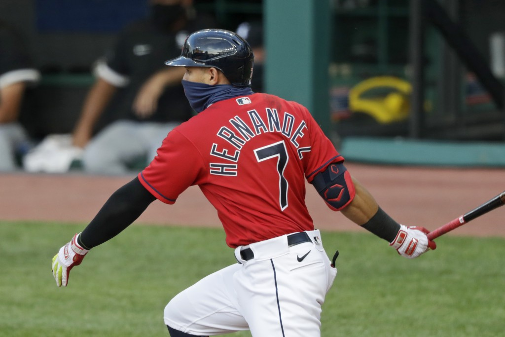 Cleveland Indians' Cesar Hernandez watches his single during the sixth inning of the team's baseball game against the Chicago White Sox, Wednesday, Ju...
