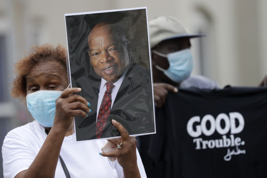 Mourners stand outside Ebenezer Baptist Church during the funeral for Rep. John Lewis at , Thursday, July 30, 2020, in Atlanta. Lewis, who carried the...