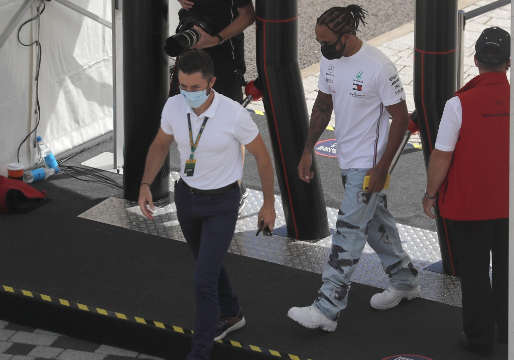 Mercedes driver Lewis Hamilton of Britain arrives ahead of the British Formula One Grand Prix at Silverstone circuit, Silverstone, England, Thursday, ...