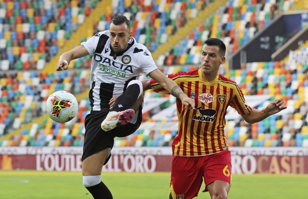 Lecce's Nehuén Paz, right, and and Udinese's Ilija Nestorovski vie for the ball during an Italian Serie A soccer match between Udinese and Lecce at th...