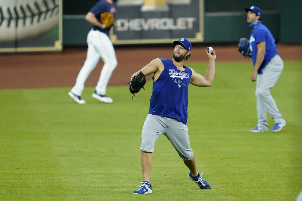 Los Angeles Dodgers pitcher Clayton Kershaw throws during batting practice before a baseball game against the Houston Astros Wednesday, July 29, 2020,...