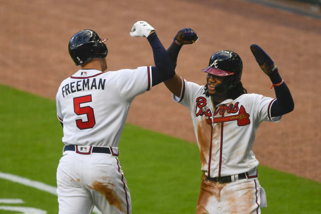 Atlanta Braves' Freddie Freeman (5) celebrates his two-run home run with Ronald Acuña during the third inning of a baseball game against the Tampa Bay...