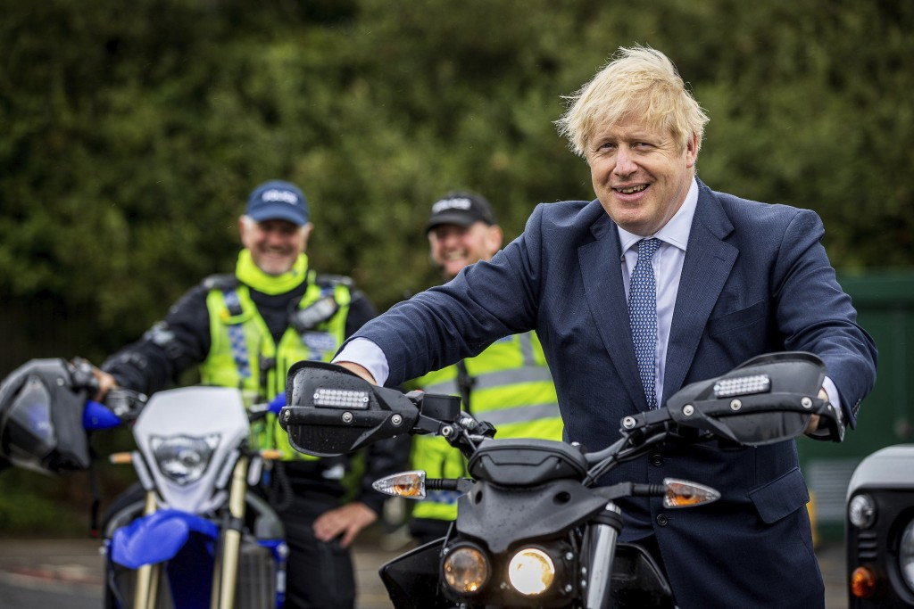 Britain's Prime Minister Boris Johnson tries out a North Yorkshire Police Rural Taskforce electric bike during a visit to North Yorkshire Police headq...