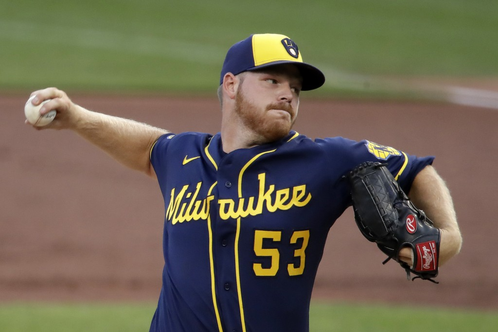 Milwaukee Brewers starting pitcher Brandon Woodruff delivers during the first inning of a baseball game against the Pittsburgh Pirates in Pittsburgh, ...