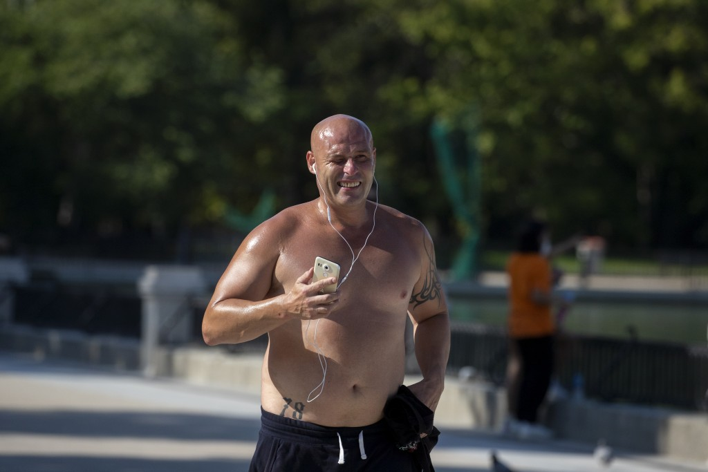 A man jogs during a hot day of summer at the Retiro park in Madrid, Spain, Wednesday, July 29, 2020. The first heat wave of the summer, which will arr...