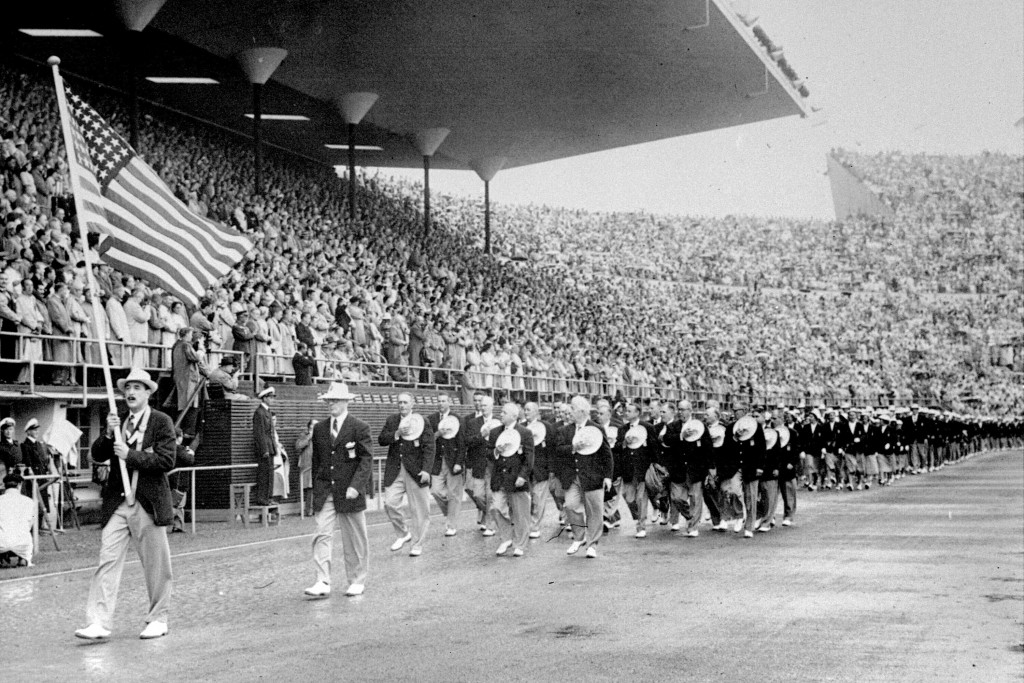 FILE - In this July 21, 1952, file photo, members of the United States Olympic team holding their hats over their hearts as they pay tribute to Finlan...