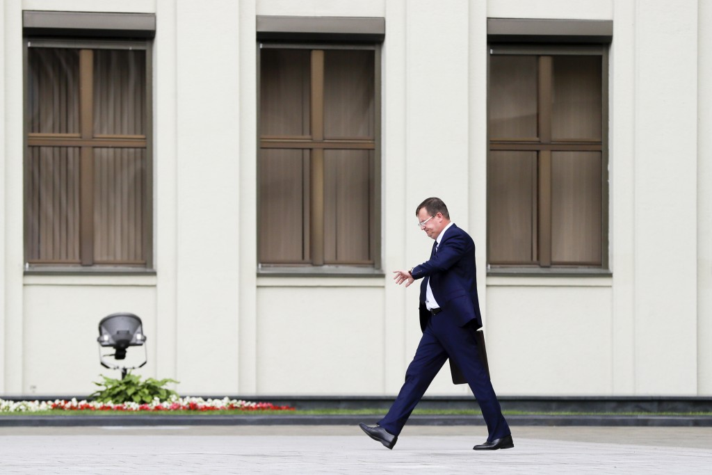 Andrei Ravkov, the head of State Secretary of the Security Council of Belarus walks after speaking to the media in Minsk, Belarus, Thursday, July 30, ...
