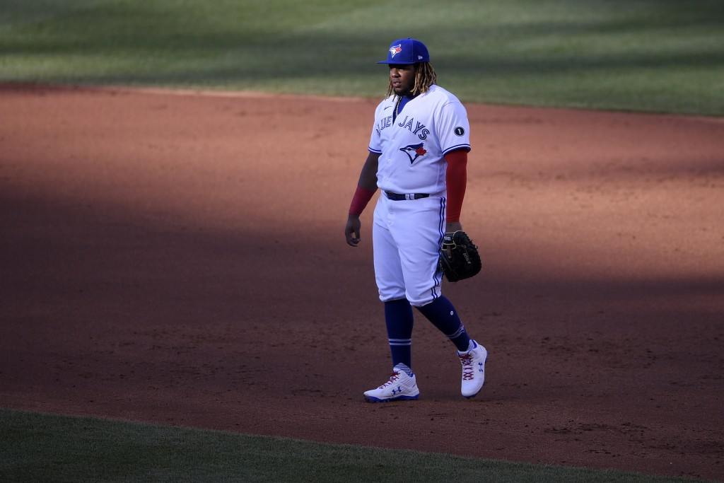 Toronto Blue Jays first baseman Vladimir Guerrero Jr. stands on the field during the third inning of a baseball game against the Washington Nationals,...