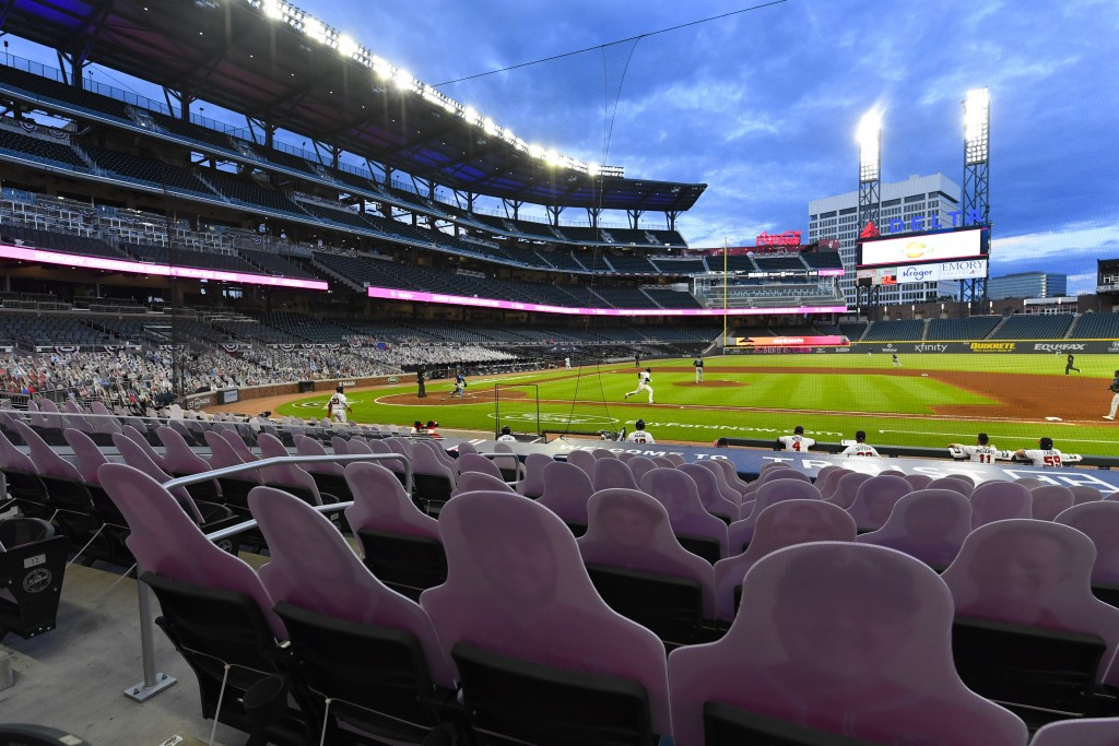 Cardboard cutouts of fans in the otherwise empty seats are in place as Atlanta Braves first baseman Freddie Freeman (5) runs to first base on a ground...