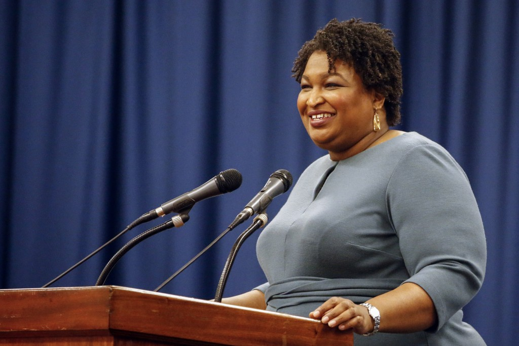 FILE - In this March 1, 2020, file photo, Stacey Abrams speaks at the unity breakfast in Selma, Ala. Many Black voters are skeptical of voting by mail...