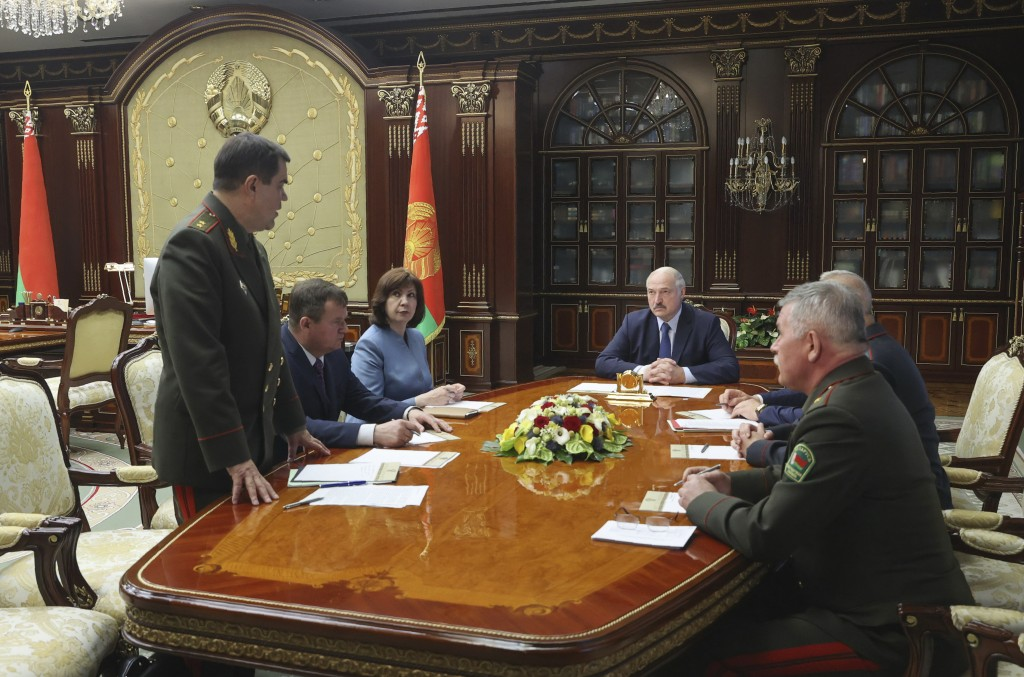 Belarusian President Alexander Lukashenko, centre right, listens to Valery Vakulchik, chief of the Belarusian state security service, KGB, during a me...