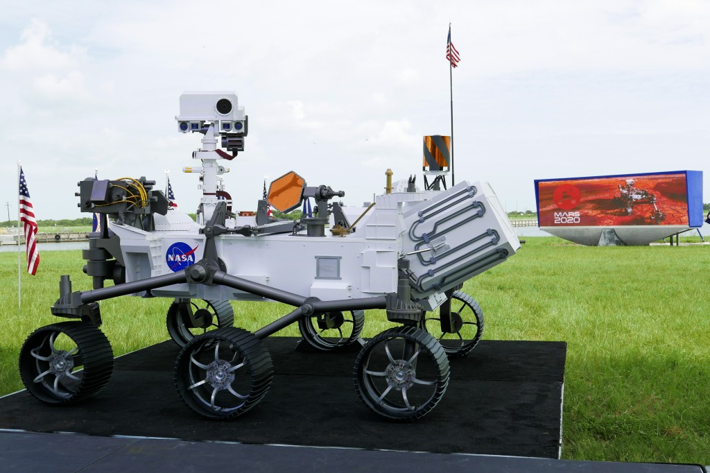A replica of the Mars rover Perseverance is displayed outside the press site before a news conference at the Kennedy Space Center Wednesday, July 29, ...
