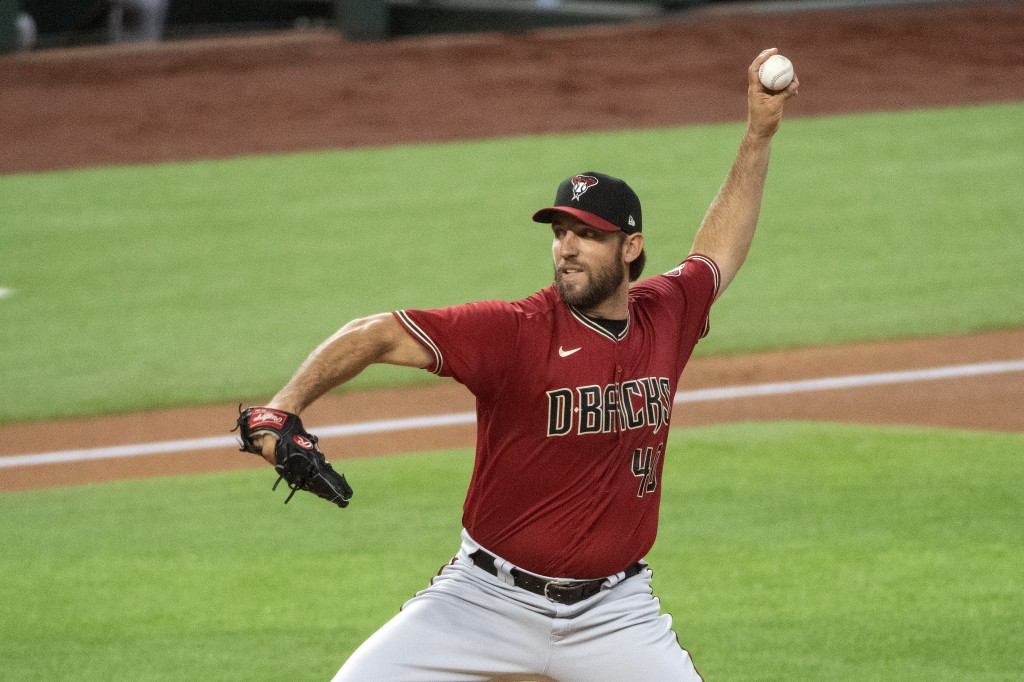 Arizona Diamondbacks Madison Bumgarner throws against the Texas Rangers during the first inning of a baseball game Wednesday, July 29, 2020, in Arling...