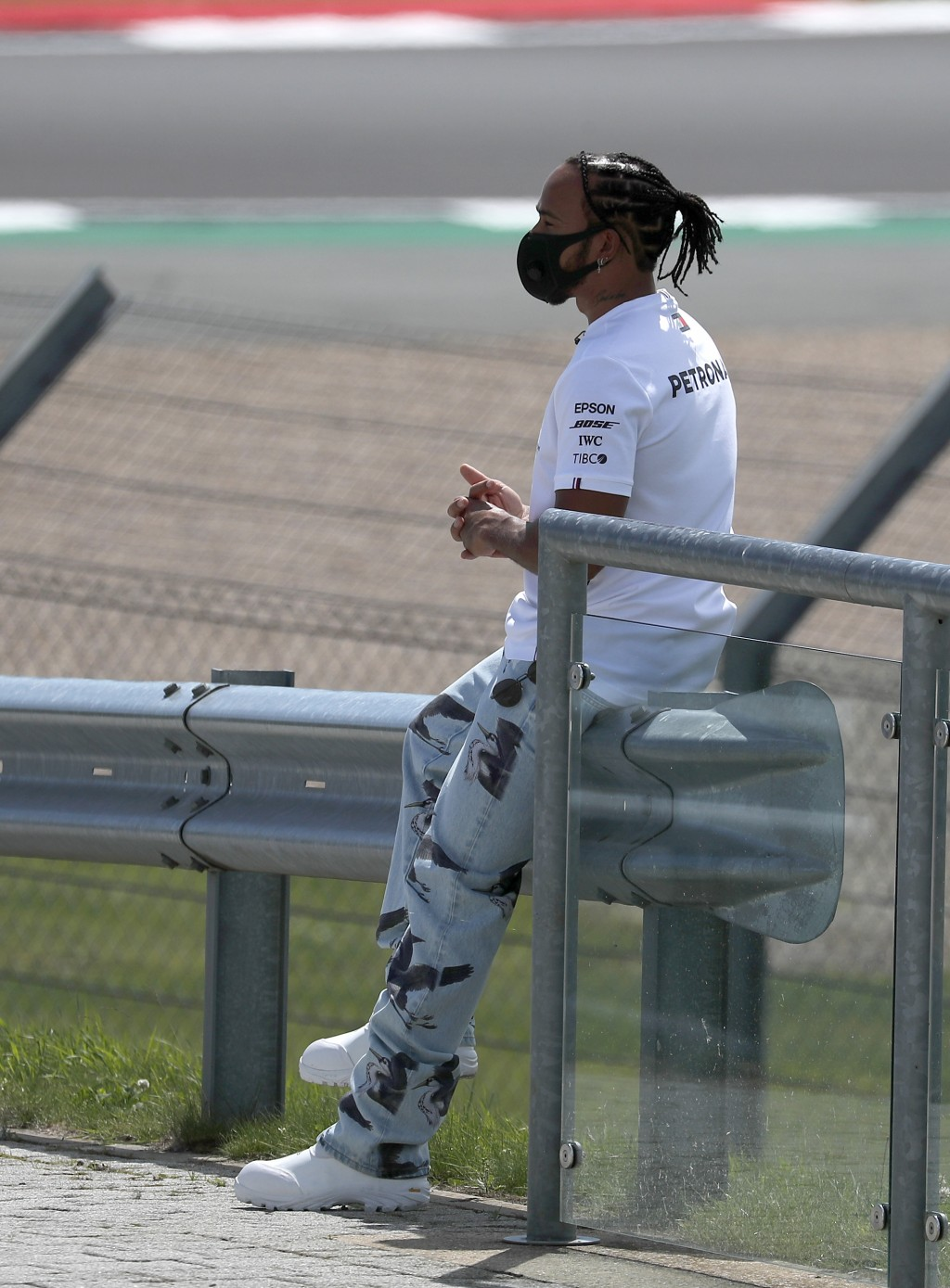 Mercedes driver Lewis Hamilton of Britain sits on the side of the track ahead of the British Formula One Grand Prix at Silverstone circuit, Silverston...