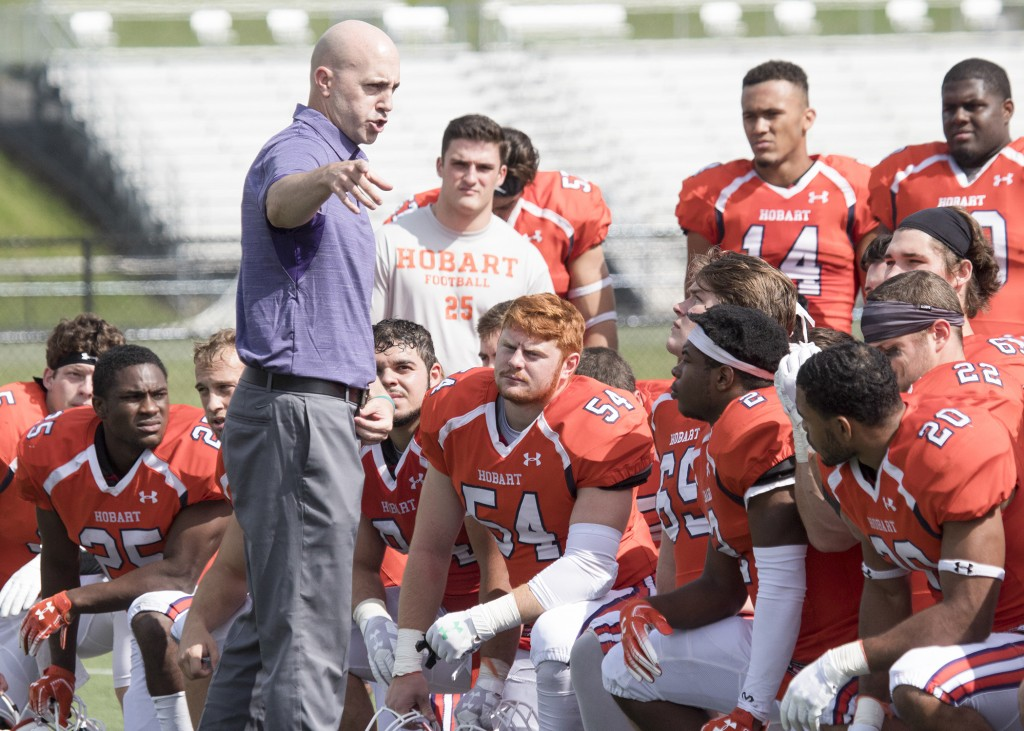 In this image provided by Hobart and William Smith Colleges, Hobart head coach Kevin DeWall addresses his team following the Statesmen's 33-7 win over...