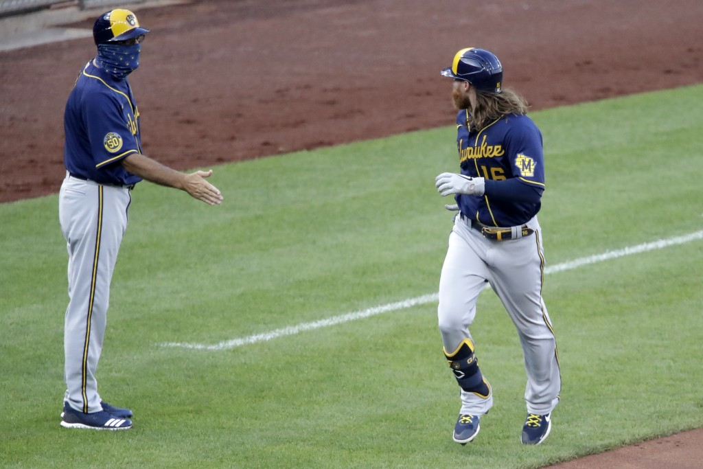 Milwaukee Brewers' Ben Gamel (16) rounds third past the outstretched hand of coach Ed Sedar after hitting a two-run home run off Pittsburgh Pirates st...