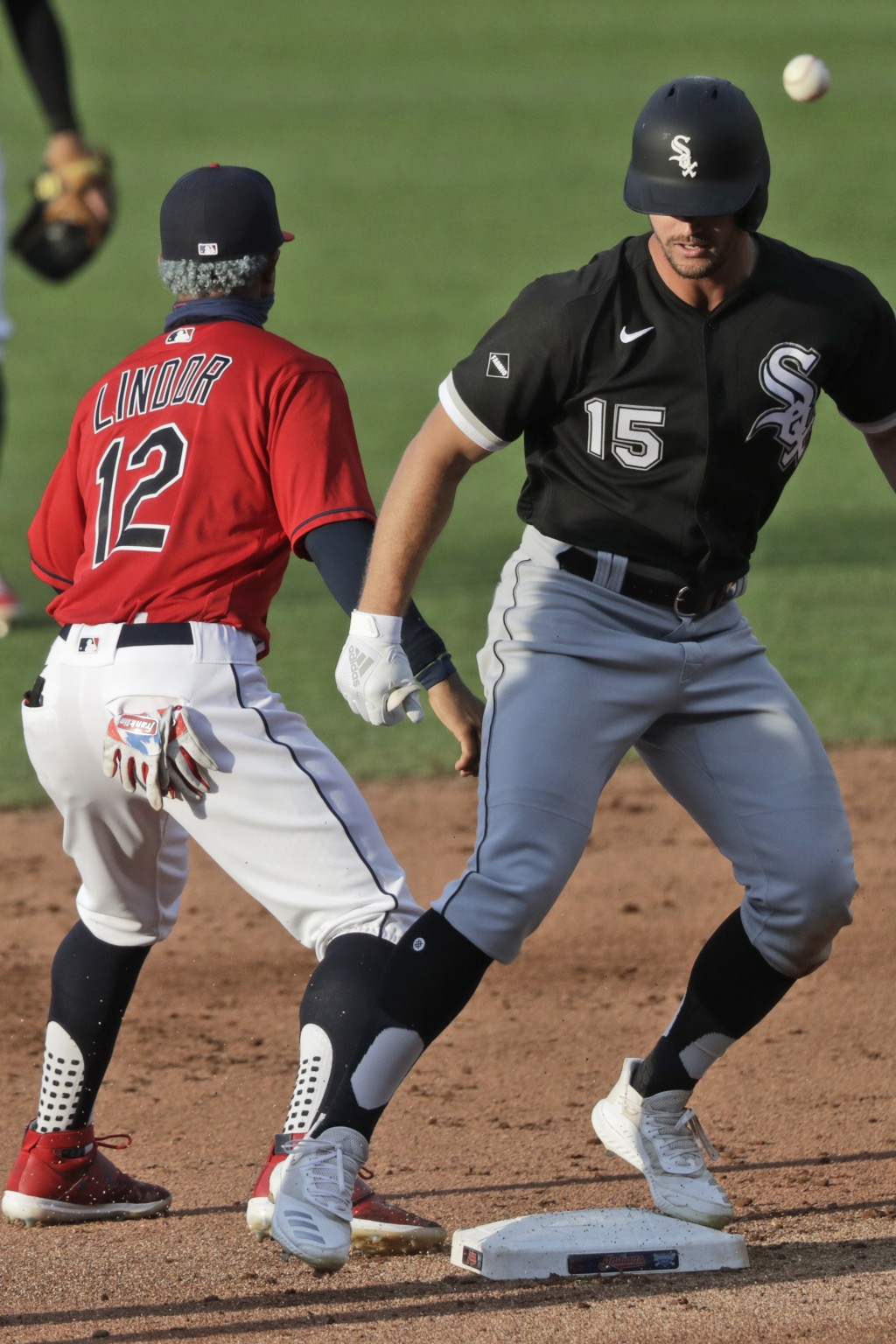 Chicago White Sox's Adam Engel (15) is safe at second base on a double as Cleveland Indians' Francisco Lindor (12) waits for the ball in the sixth inn...