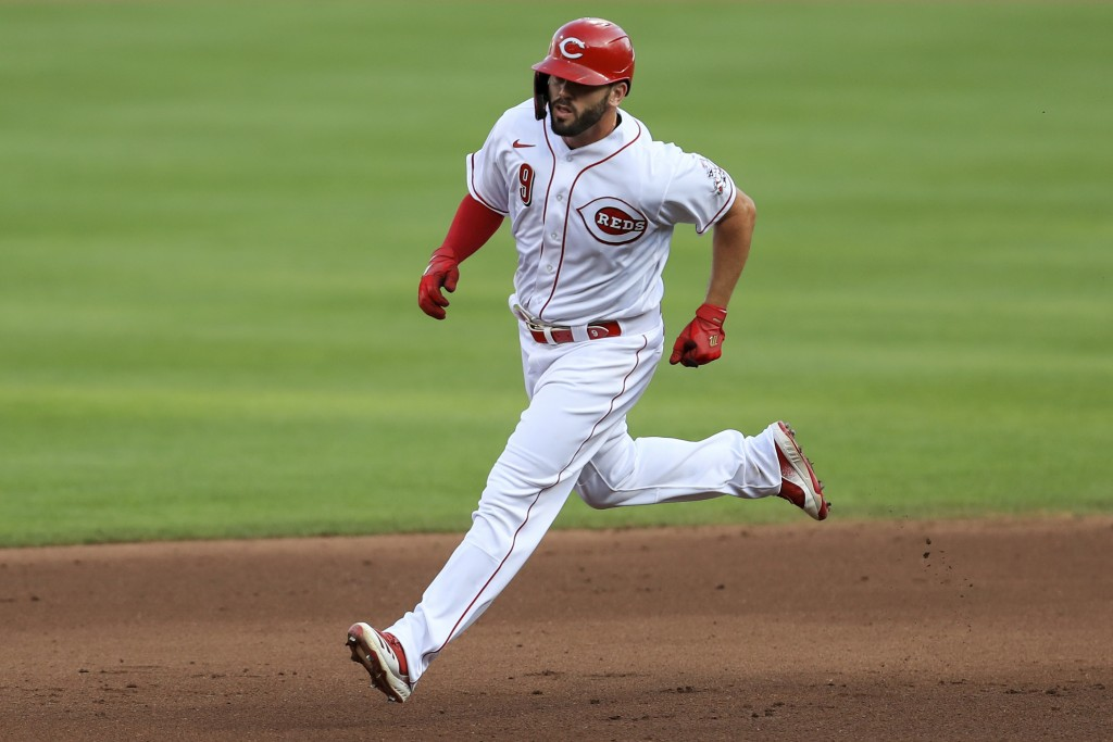 Cincinnati Reds' Mike Moustakas runs the bases after hitting a two-run home run during the fourth inning of the team's baseball game against the Chica...