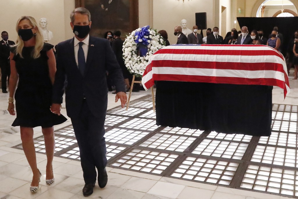 Gov. Brian Kemp and his wife Marty Kemp, leave the capital after a service for Rep. John Lewis lying in repose at the state capital, Wednesday, July 2...