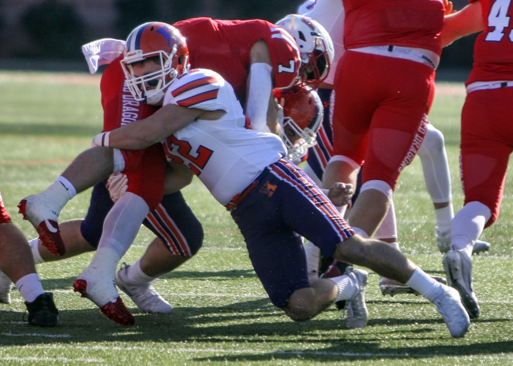 In this image provided by Hobart and William Smith Colleges, Hobart linebacker Emmett Forde tackles Cortland running back Zach Tripodi during the 2019...