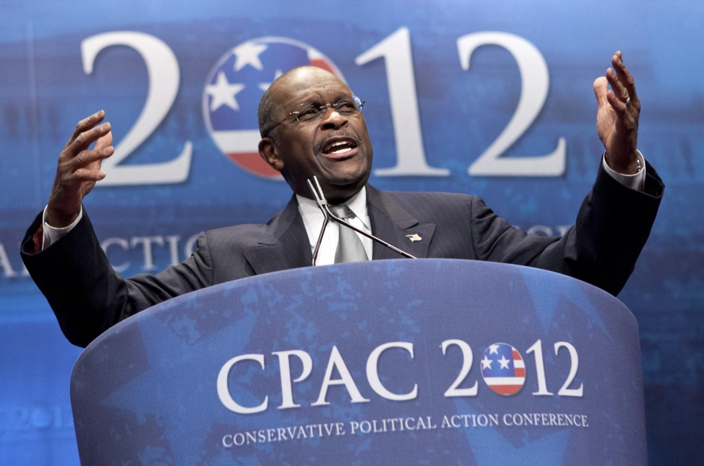 FILE - In this Feb. 9, 2012 file photo, former presidential candidate Herman Cain addresses the Conservative Political Action Conference in Washington...
