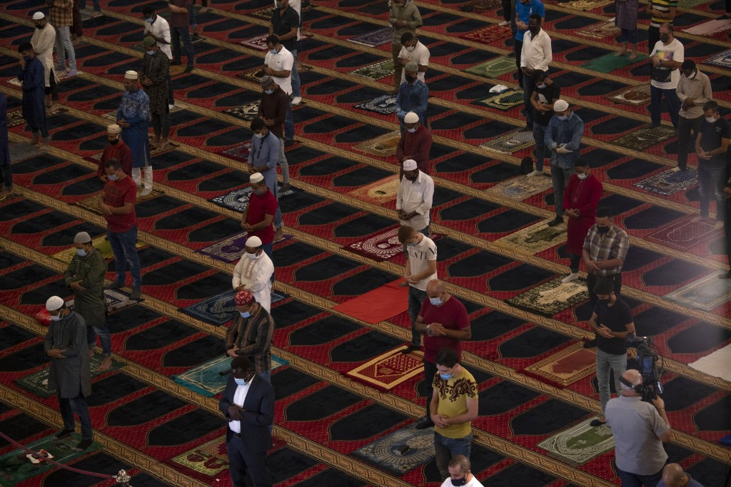 Muslim worshippers wearing masks to help stop the spread of the coronavirus, offer Eid al-Adha prayer while maintaining a social distance at the Moham...