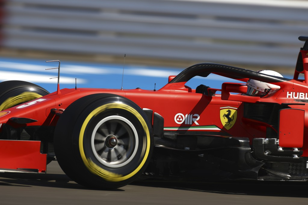 Ferrari driver Sebastian Vettel of Germany steers his car during the first practice session for the British Formula One Grand Prix at the Silverstone ...