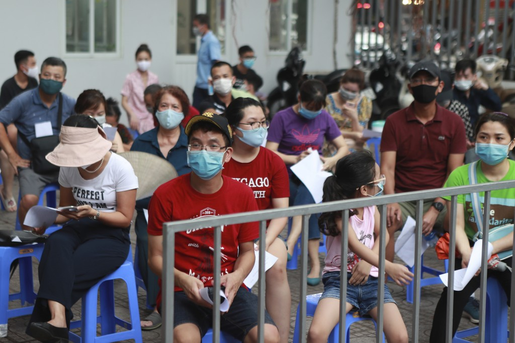 People wait in line for COVID-19 test in Hanoi, Vietnam, Friday, July 31, 2020. Vietnam reported on Friday the country's first ever death of a person ...