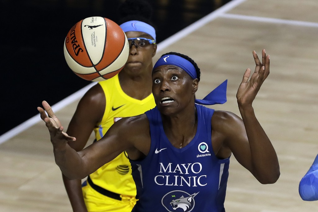 Minnesota Lynx center Sylvia Fowles (34) reaches for the ball in front of Chicago Sky guard Diamond DeShields (1) during the first half of a WNBA bask...
