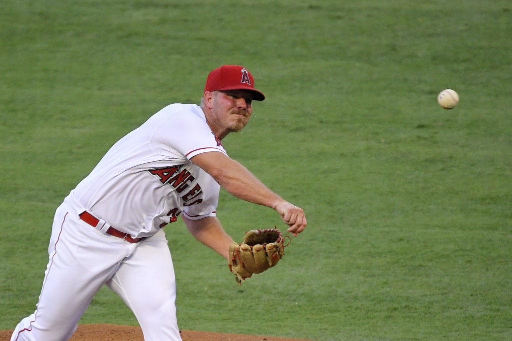 Los Angeles Angels starting pitcher Dylan Bundy throws to the plate during the first inning of a baseball game against the Seattle Mariners Thursday, ...