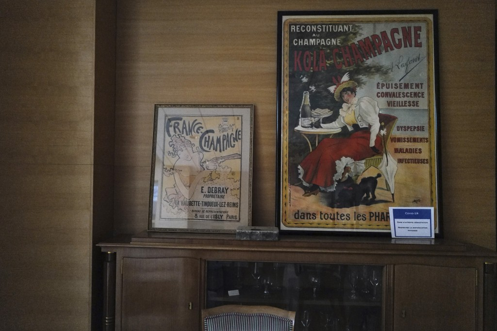 Old posters of champagne advertising displayed in the room of the Champagne Committee, an organization that represents some 16,000 winemakers and 300 ...