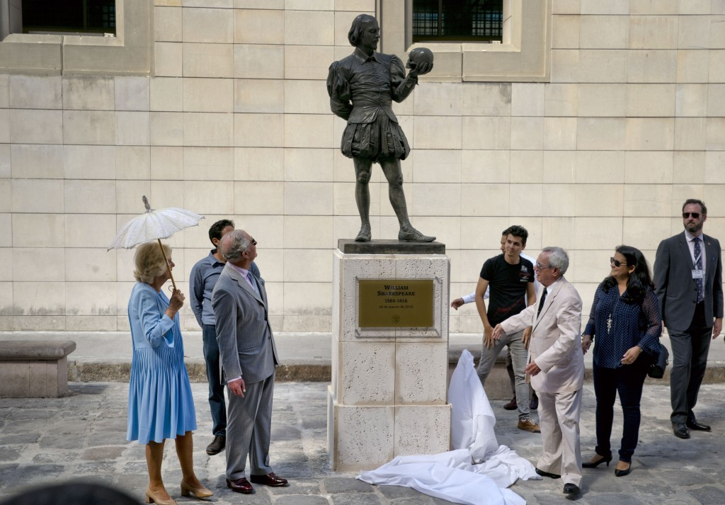 FILE - In this March 25, 2019 file photo, Havana City Historian Eusebio Leal Spengler, front right, unveils a statue of William Shakespeare during a v...