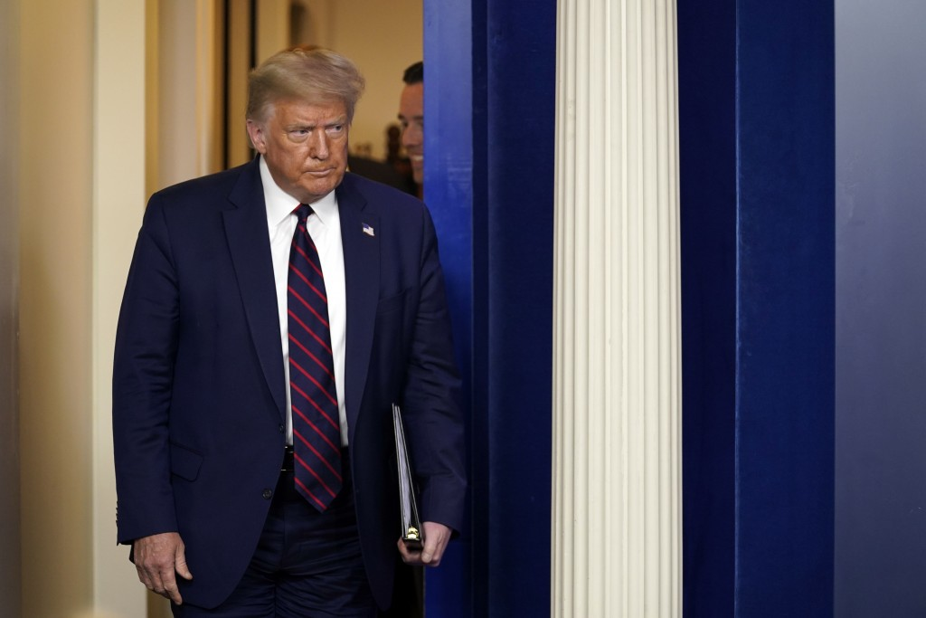 President Donald Trump arrives to speak at a news conference at the White House, Thursday, July 30, 2020, in Washington. (AP Photo/Evan Vucci)