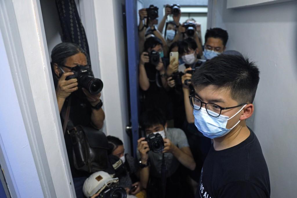 Hong Kong pro-democracy activist Joshua Wong attends a press conference in Hong Kong, Friday, July 31, 2020. On Thursday, 12 pro-democracy candidates ...