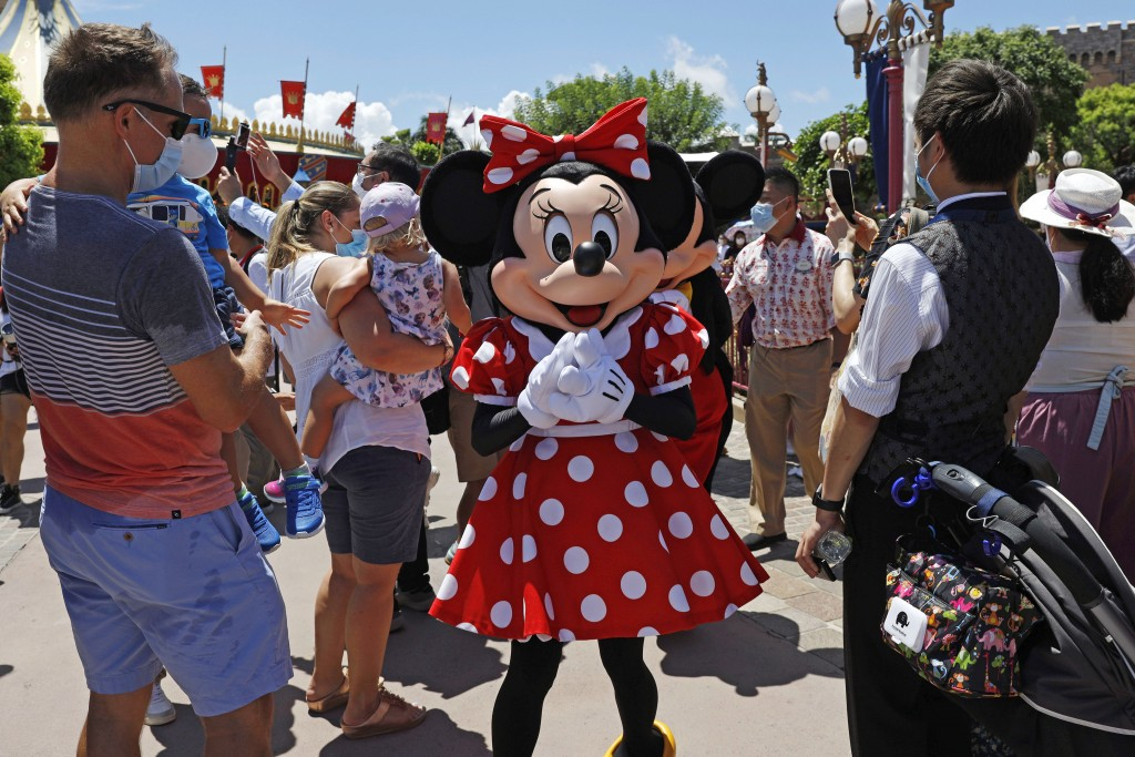The iconic cartoon character Minnie Mouse reacts to visitors at the Hong Kong Disneyland Thursday, June 18, 2020. In March, Hong Kong closed its borde...
