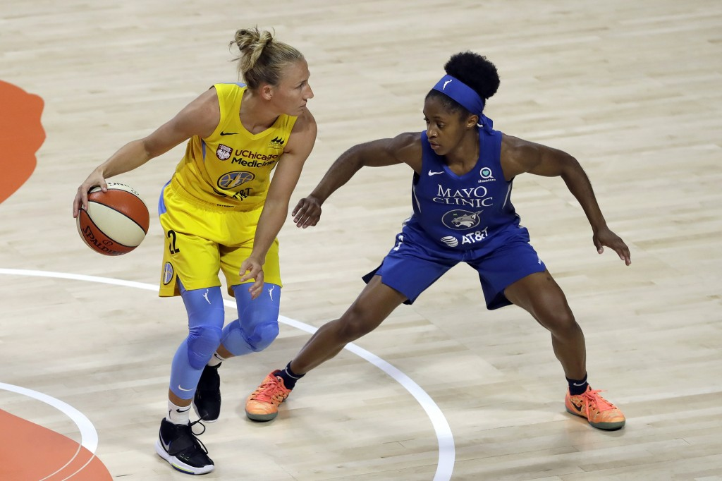 Chicago Sky guard Courtney Vandersloot (22) works against Minnesota Lynx guard Crystal Dangerfield (2) during the first half of a WNBA basketball game...