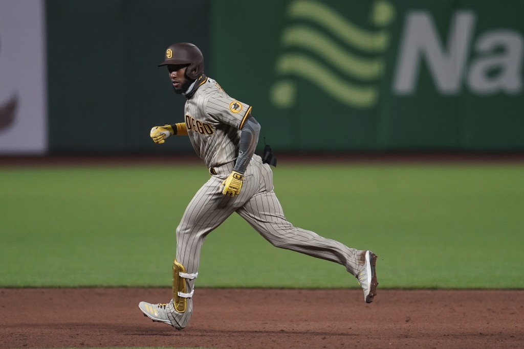 San Diego Padres' Jurickson Profar rounds the bases after hitting a two-run home run against the San Francisco Giants during the sixth inning of a bas...