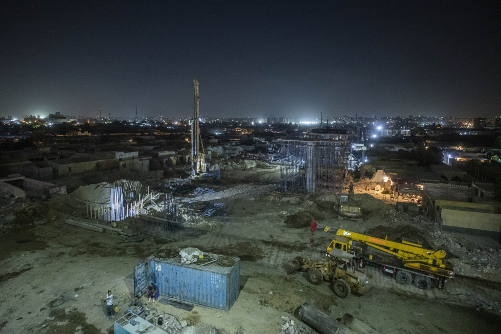 Construction work on a highway flyover in a portion cleared of graves in the City of Dead in Cairo, Egypt, Sunday, July 26, 2020. The overpass cuts th...