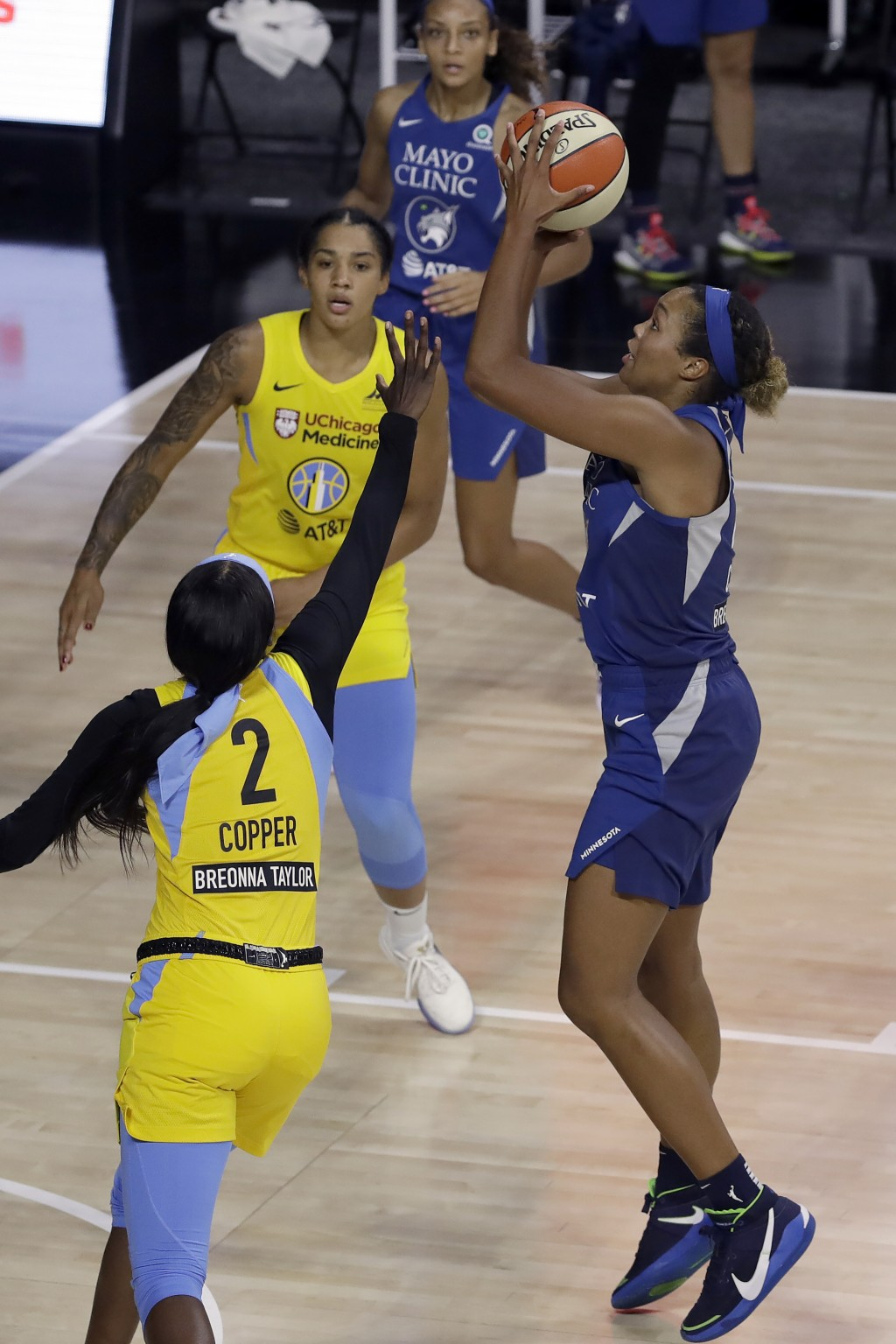 Minnesota Lynx forward Napheesa Collier (24) shoots over Chicago Sky guard Kahleah Copper (2) and forward Gabby Williams (15) during the first half of...