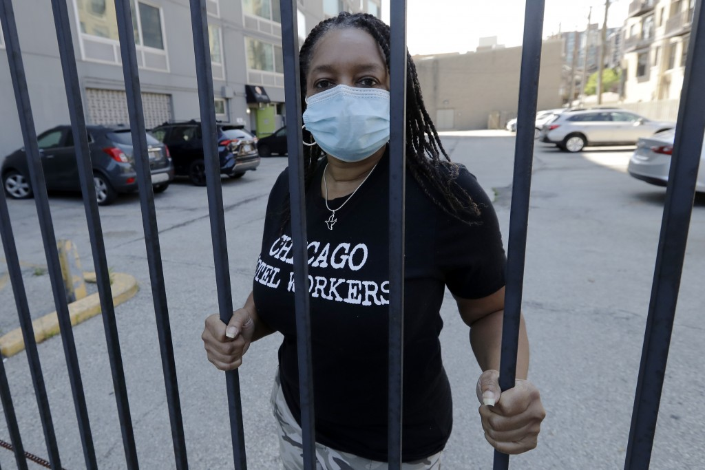 Roushaunda Williams poses for a photo in Chicago Thursday, July, 23, 2020. Financial challenges keep piling up for Williams months after she lost her ...