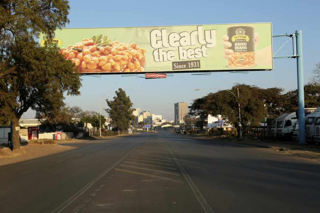 A road is deserted in Harare, Friday, July, 31, 2020. Zimbabwe's capital, Harare, was deserted Friday, as security agents vigorously enforced the coun...