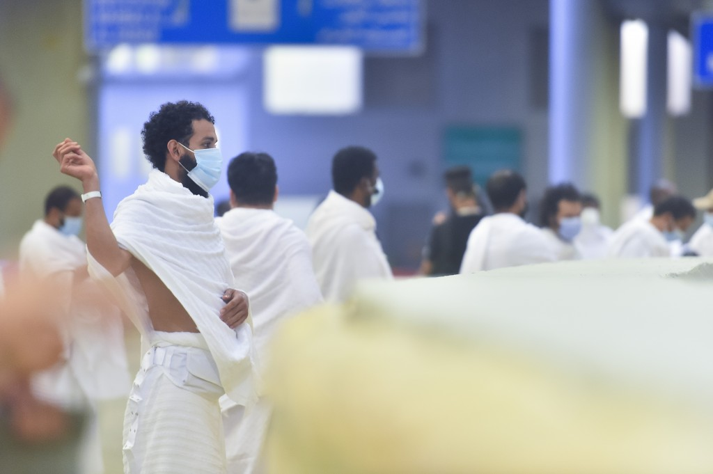 Muslim pilgrims cast stones at a pillar in the symbolic stoning of the devil, the last rite of the annual hajj, and the second day of Eid al-Adha, in ...